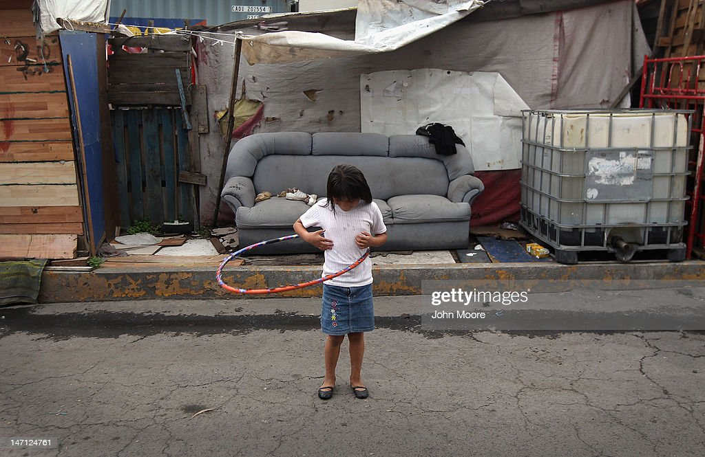 Samara Lopez, 7, plays outside her family home in a squatters village on June 25, 2012 in Mexico City, Mexico. Residents of the neighborhood, known as Telecommunications, moved onto the city property 6 years ago and live without running water, have little electricity and are subject to frequent flooding from rainstorms. Although incomes have risen nationwide in recent years, Mexico's vast income disparity is a major theme ahead of Sunday's upcoming presidential election.
