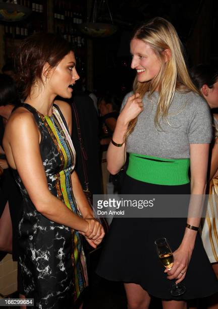 Samara Weaving talks to Candice Lake at the NetaPortercom Fashion week cocktail party at Ananas on April 11 2013 in Sydney Australia