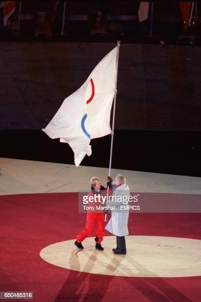 Samarach and the Deedee Corradini Major of Salt Lake City with the Olympic flag