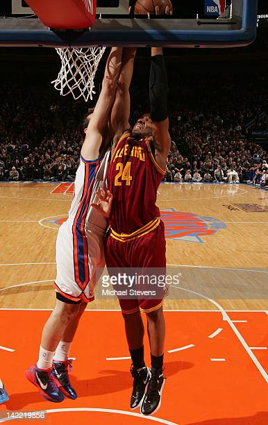 Samardo Samuels of the Cleveland Cavaliers goes to the basket against Josh Harrellson of the New York Knicks during the game on March 31 2012 at...