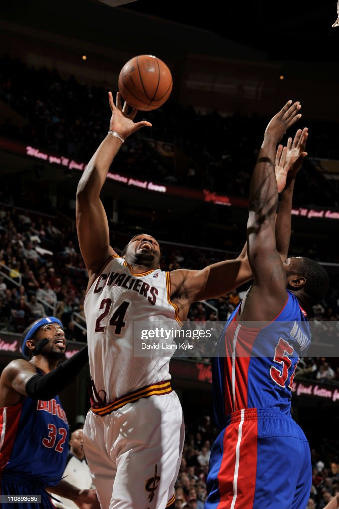 Samardo Samuels #24 of the Cleveland Cavaliers shoots against Jason Maxiell #54 of the Detroit Pistons during the game at The Quicken Loans Arena on March 25, 2011 in Cleveland, Ohio.