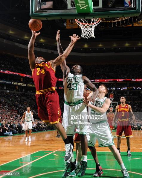 Samardo Samuels of the Cleveland Cavaliers shoots against Kendrick Perkins of the Boston Celtics during the game on January 25 2011 at the TD Garden...
