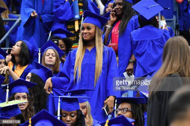 Samaria Leah Smith sits in the crowd during The Fashion Institute of Technology's 2017 Commencement Ceremony at Arthur Ashe Stadium on May 25 2017 in...