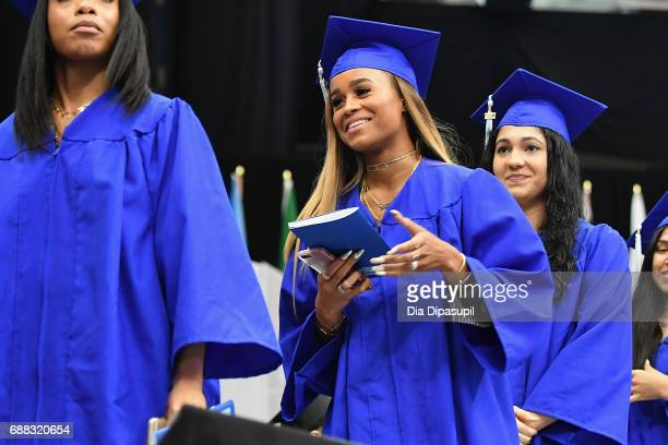 Samaria Leah Smith walks to receive her diploma during The Fashion Institute of Technology's 2017 Commencement Ceremony at Arthur Ashe Stadium on May...