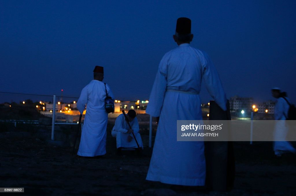 Samaritan worshipers gather to pray on top of Mount Gerizim near the northern West Bank city of Nablus to celebrate the Shavuot festival at dawn on...