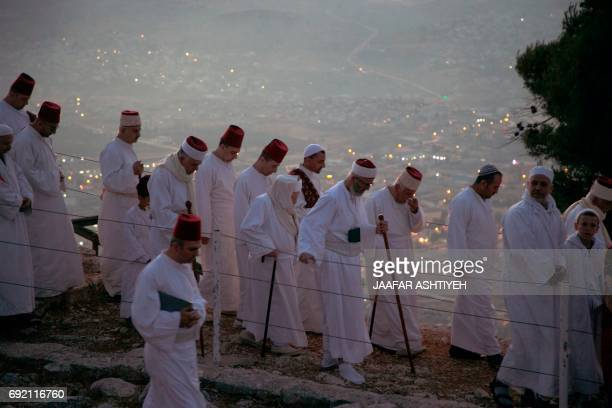 Samaritan worshipers gather to pray on top of Mount Gerizim near the northern West Bank city of Nablus as they celebrate the Shavuot festival at dawn...