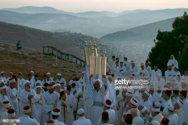 Samaritan worshipers pray on top of Mount Gerizim near the northern West Bank city of Nablus as they celebrate the Shavuot festival at dawn on June 4...
