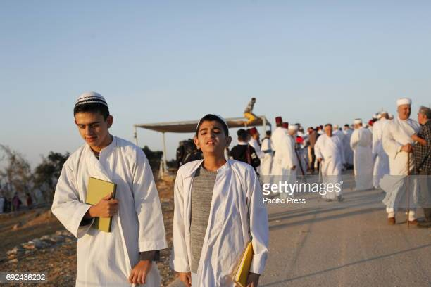 Samaritans participate in a traditional ceremony celebrating the giving of the Torah on 'Shavuot festival' at Mount Gerizim near the West Bank city...