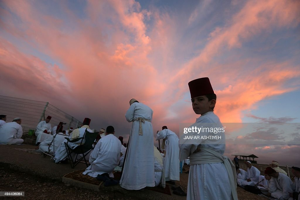Samaritans pray on top of Mount Gerizim near the northern West Bank city of Nablus on October 27 2015 during Sukkot celebrations The Samaritans are a...