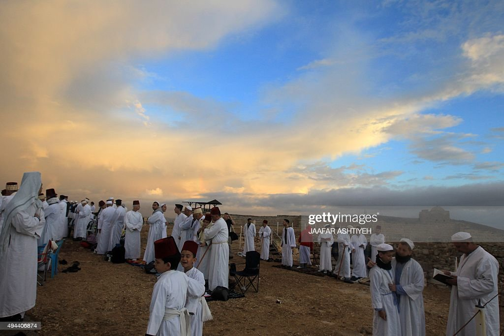 Samaritans pray on top of Mount Gerizim near the northern West Bank city of Nablus on October 27 2015 during Sukkot celebrations Sukkot marks the...