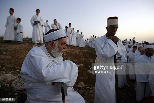 Samaritans pray on top of Mount Gerizim near the northern West Bank city of Nablus as they celebrate the Shavuot festival at dawn on June 15 2008...
