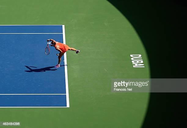 Samatha Stosur of Australia serves in her match against Mirjana LucicBaroni of Croatia during day one of the WTA Dubai Duty Free Tennis Championship...