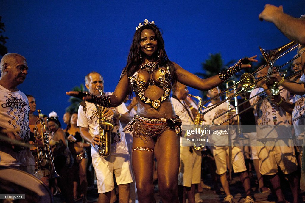 A samba dancer performs on the Copacabana beach during Carnival celebrations in Rio de Janeiro, Brazil, on Saturday, Feb. 9, 2013. The festivities, which are expected to attract almost 900,000 visitors, precede the start of Lent, which begins with Ash Wednesday on Feb. 13. Photographer: Dado Galdieri/Bloomberg via Getty Images
