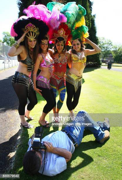 Samba dancers Fiona Hay Georgina Anderson Thraissa Luna and Gillian Harkness from dance troupe Eletricat have their photograph taken during a...