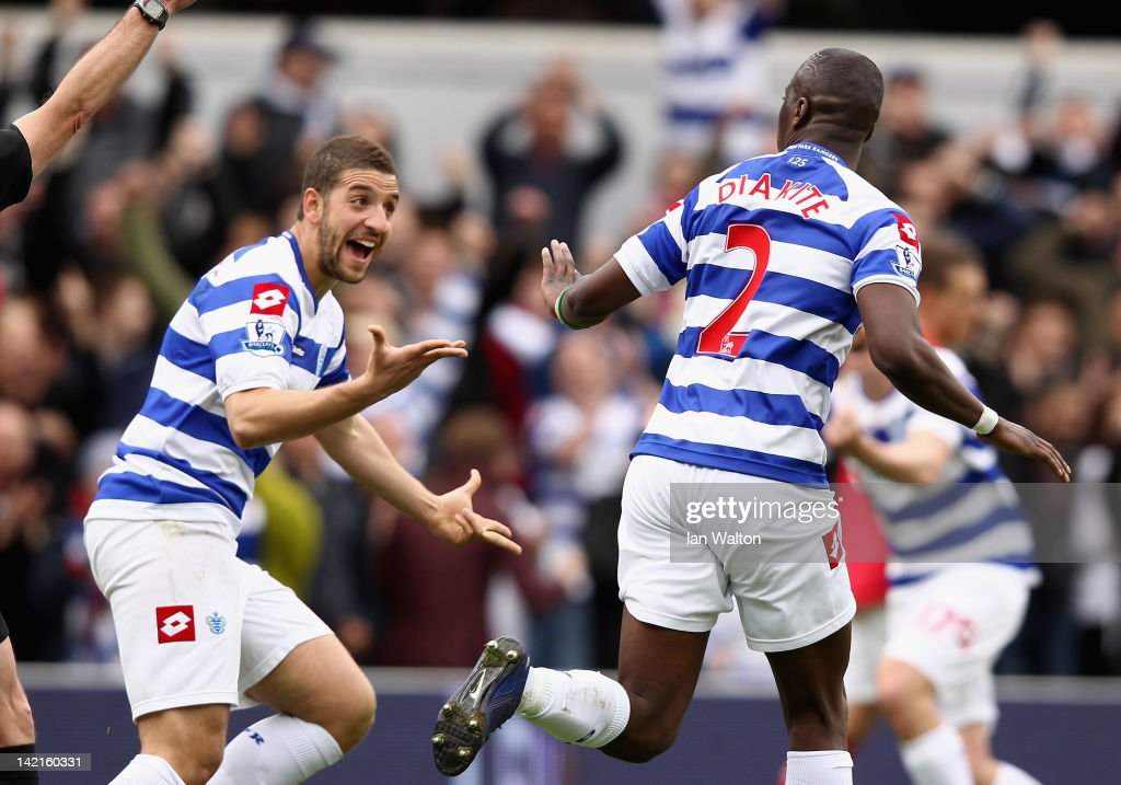 Samba Diakite of Queens Park Rangers celebrates scoring his side's second goal with team mate <a gi-track='captionPersonalityLinkClicked' href=/galleries/search?phrase=Adel+Taarabt&family=editorial&specificpeople=3275547 ng-click='$event.stopPropagation()'>Adel Taarabt</a> (L) during the Barclays Premier League match between Queens Park Rangers and Arsenal at Loftus Road on March 31, 2012 in London, England.