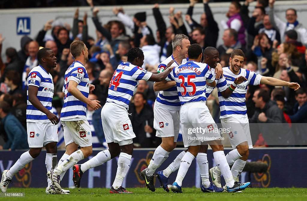 Samba Diakite of Queens Park Rangers (second right) celebrates scoring his side's second goal with team mates during the Barclays Premier League match between Queens Park Rangers and Arsenal at Loftus Road on March 31, 2012 in London, England.
