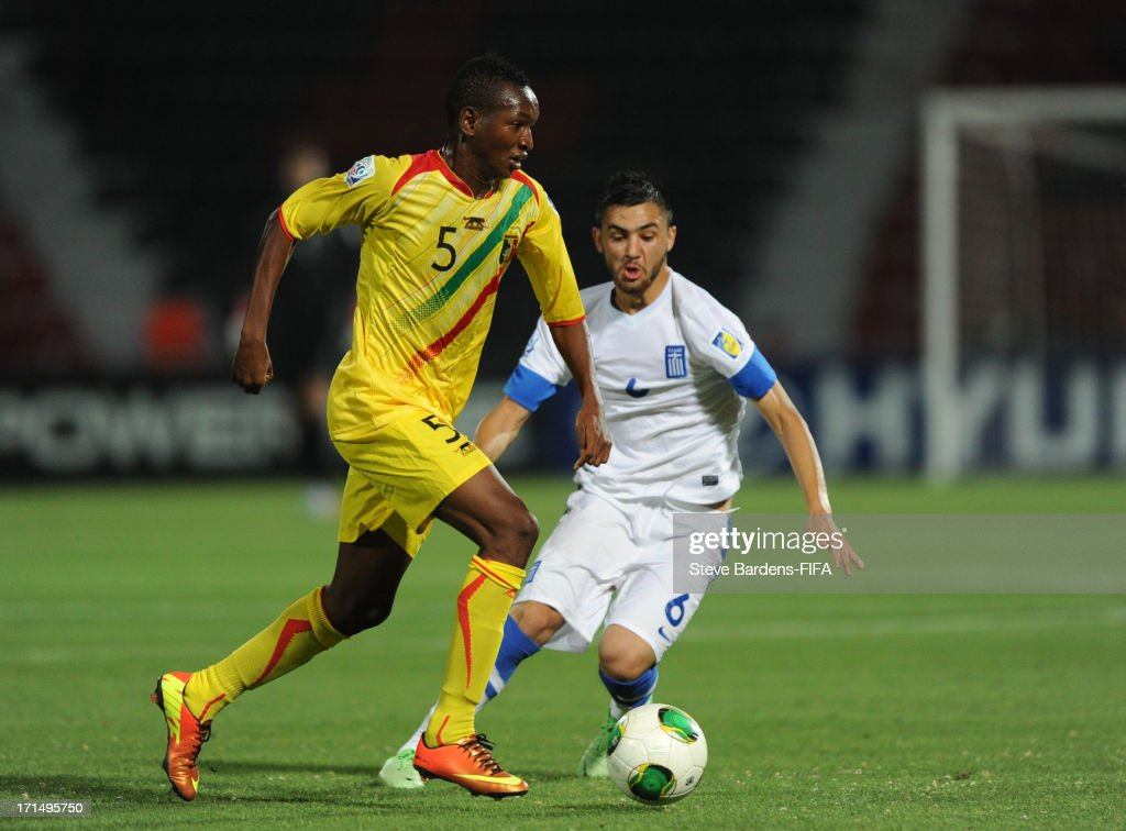 Samba Diallo of Mali breaks away from Panagiotis Ballas of Greece during the FIFA U20 World Cup Group D match between Mali and Greece at Kamil Ocak Stadium on June 25, 2013 in Gaziantep, Turkey.