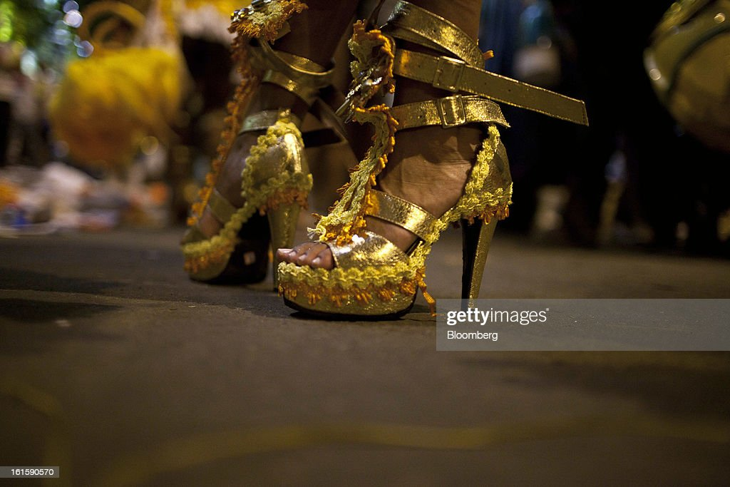 A samba performer stands in her high heels after a parade in the Sambadrome during Carnival celebrations in Rio de Janeiro, Brazil, on Monday, Feb. 11, 2013. The festivities, which are expected to attract almost 900,000 visitors, precede the start of Lent, which begins with Ash Wednesday on Feb. 13. Photographer: Dado Galdieri/Bloomberg via Getty Images