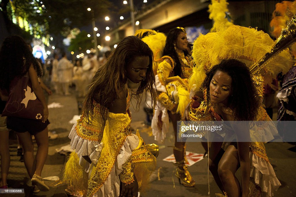 Samba performers begin to remove their costumes after participating in a parade during Carnival celebrations in Rio de Janeiro, Brazil, on Monday, Feb. 11, 2013. The festivities, which are expected to attract almost 900,000 visitors, precede the start of Lent, which begins with Ash Wednesday on Feb. 13. Photographer: Dado Galdieri/Bloomberg via Getty Images
