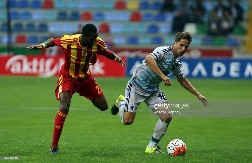 Samba Sow of Kayserispor in action against Diego Ribas of Fenerbahce during the Turkish Spor Toto Super League football match between Kayserispor and...