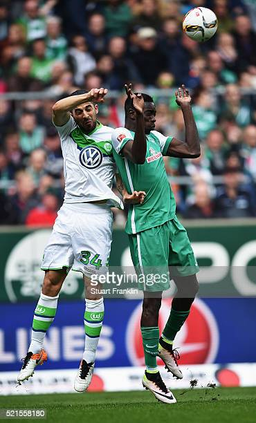 Sambou Yatabaré of Bremen is challenged by Ricardo Rodríguez of Wolfsburg during the Bundesliga match between Werder Bremen and VfL Wolfsburg at...