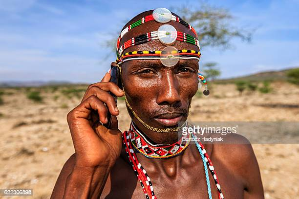 Samburu tribe warrior using mobile phone, central Kenya, East Africa