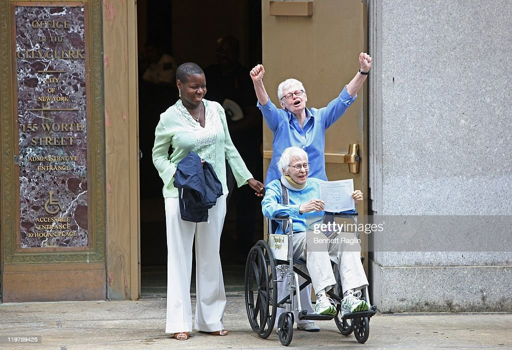 Same sex couple Phyllis Siegel (arms raised) and Connie Kopelov (sitting) celebrate their wedding during the first day of legal same-sex marriage in New York State on July 24, 2011 in New York City.