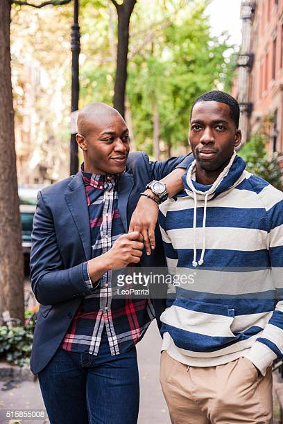 Same sex couple posing in New York city streets