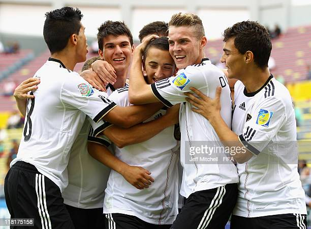 Samed Yesil of Germany celebrates with Emre Can Robin Yalcin Marvin Ducksch and Kaan Ayhan after scoring during the FIFA U17 World Cup quarter final...
