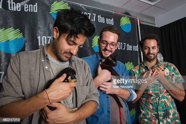 Sameer Gadhia Francois Comtois and Eric Cannata of the band Young The Giant hold puppies and a kitten brought by Motley Zoo Animal Rescue backstage...