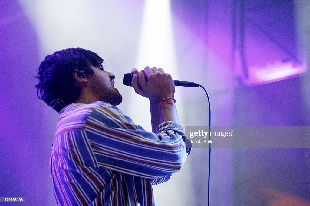 Sameer Gadhia of the band Young The Giant performs during MusicfestNW 2013 at Pioneer Courthouse Square on September 5, 2013 in Portland, Oregon.