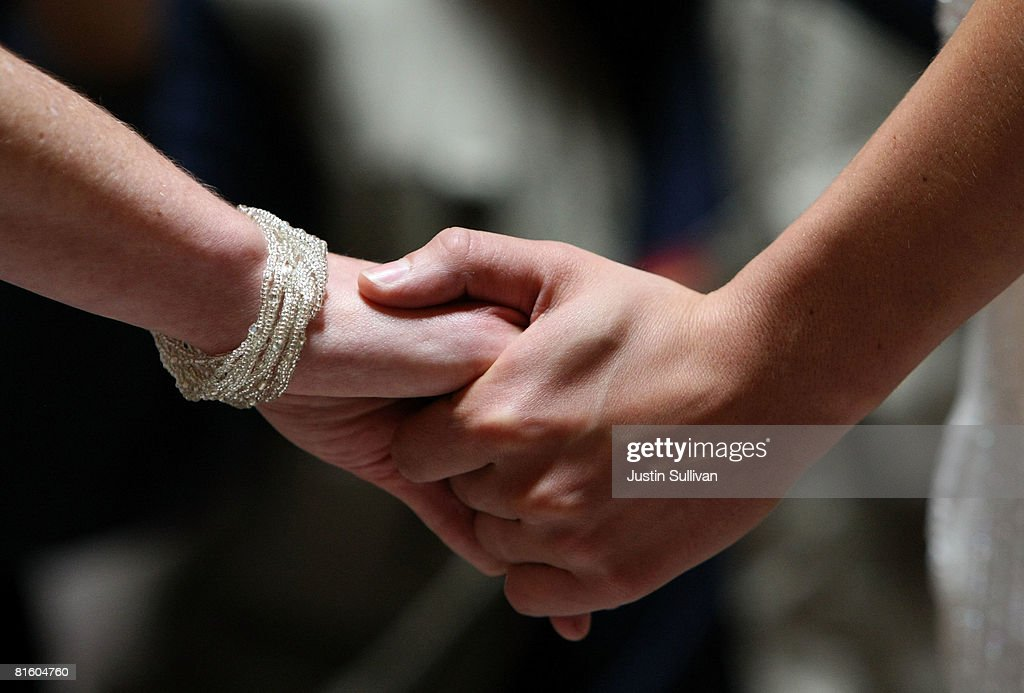 Samesex couple Amber Weiss and Sharon Papo hold hands as they get married at San Francisco City Hall June 17 2008 in San Francisco California Samesex...