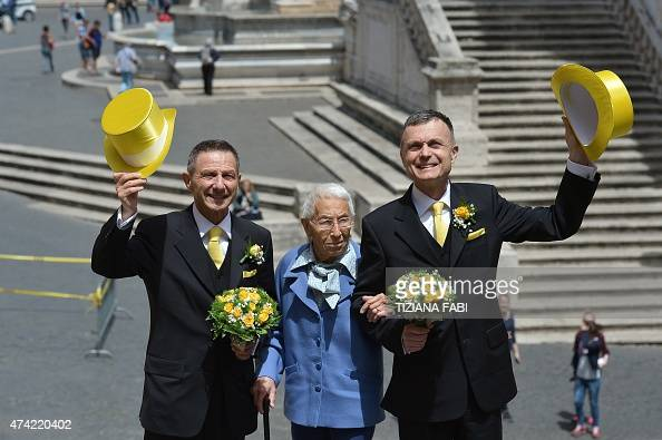 Samesex couple Angelo Albanesi and Giorgio de Simoni arrive at Rome's city hall to register a civil union on May 21 2015 in Rome The city of Rome...