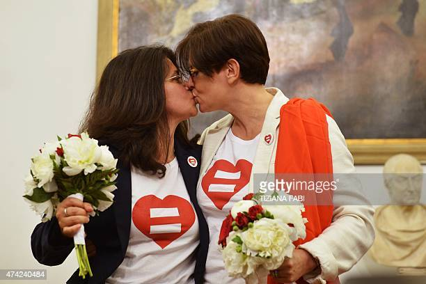 Samesex couple Daniela Bellisario and Barbara Vecchieti kiss after they registered their civil union at Rome's city hall on May 21 2015 in Rome The...