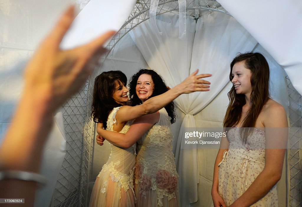 Same-sex couple for Andrea Taylor, 41, (L) reaches for her partner Sallee Taylor's, 41, (C) Grace Meier, 15, for a hug after the couple were married at a wedding ceremony on July 1, 2013 in West Hollywood, California. The U.S. Ninth Circuit Court of Appeals lifted California's ban on same-sex marriages just three days after the Supreme Court ruled that supporters of the ban, Proposition 8, could not defend it before the high court. California Gov. Jerry Brown ordered all counties in the state to begin issuing licenses immediately.