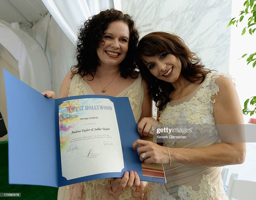 Same-sex couple for Sallee Taylor, 41, (L) and Andrea Taylor, 41, hold their marriage certificate after they were married at a wedding ceremony on July 1, 2013 in West Hollywood, California. The U.S. Ninth Circuit Court of Appeals lifted California's ban on same-sex marriages just three days after the Supreme Court ruled that supporters of the ban, Proposition 8, could not defend it before the high court. California Gov. Jerry Brown ordered all counties in the state to begin issuing licenses immediately.