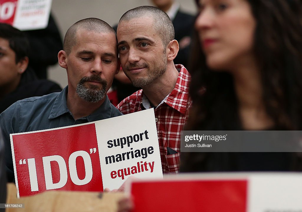 Same-sex couple Frank Capley (L) and Joe Alfano (R) look on before staging a sit-in protest after same-sex couples were denied marriage licenses from the San Francisco county clerk on February 14, 2013 in San Francisco, California. Close to a dozen same-sex couples who were denied marriage licenses were arrested after they staged a sit-in demonstration inside the office of San Francisco's county clerk.