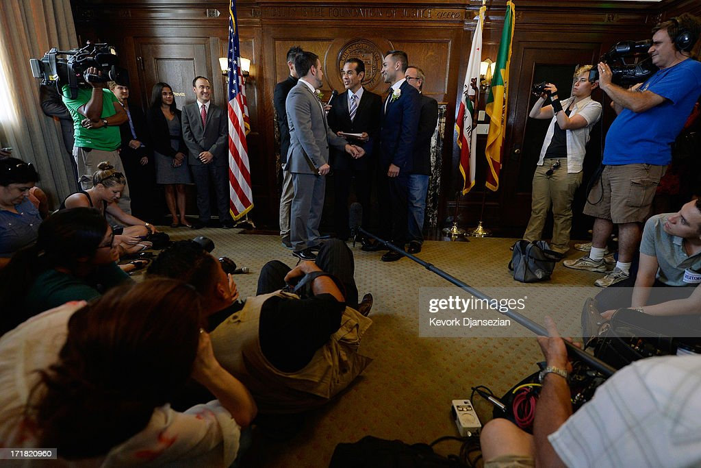 Same-sex couple Jeff Zarillo (L) and Paul Katami are married at Los Angeles City Hall by Los Angeles Mayor <a gi-track='captionPersonalityLinkClicked' href=/galleries/search?phrase=Antonio+Villaraigosa&family=editorial&specificpeople=178925 ng-click='$event.stopPropagation()'>Antonio Villaraigosa</a> (C) on June 28, 2013 in Los Angeles, California. The U.S. Ninth Circuit Court of Appeals lifted California's ban on same-sex marriages just three days after the Supreme Court ruled that supporters of the ban, Proposition 8, could not defend it before the high court. California Gov. Jerry Brown ordered all counties in the state to begin issuing licenses immediately.
