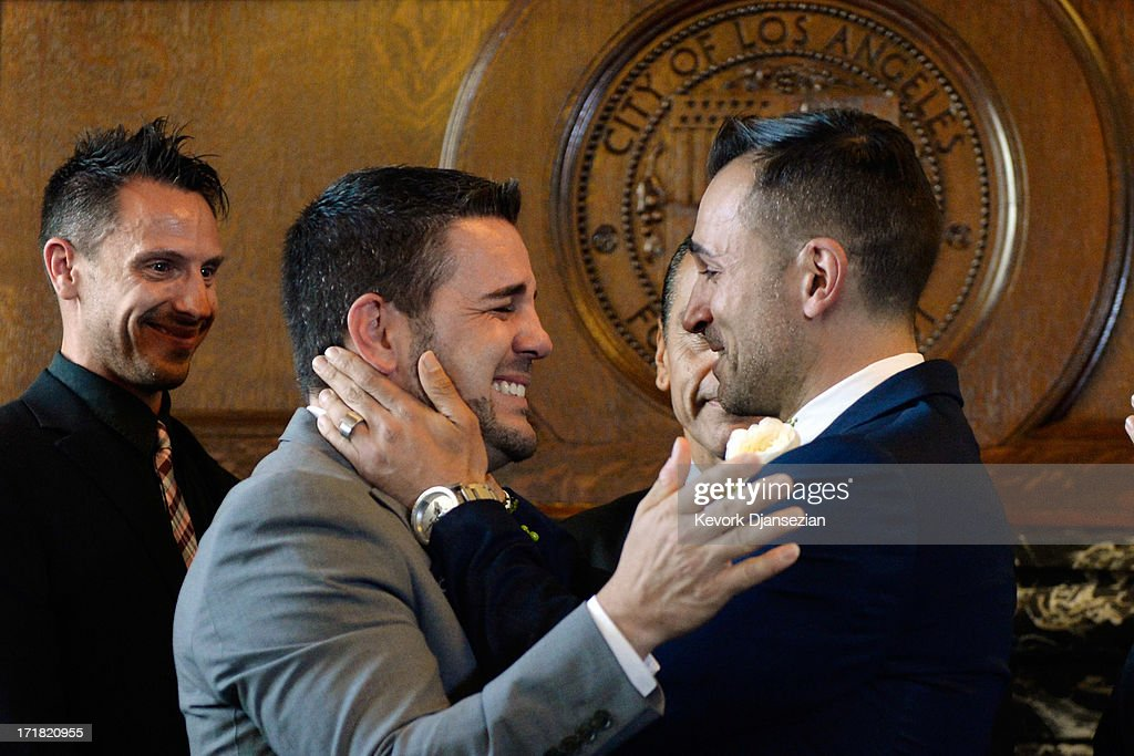 Same-sex couple Jeff Zarillo (2L) and Paul Katami (R) hug after they were married at Los Angeles City Hall by Los Angeles Mayor <a gi-track='captionPersonalityLinkClicked' href=/galleries/search?phrase=Antonio+Villaraigosa&family=editorial&specificpeople=178925 ng-click='$event.stopPropagation()'>Antonio Villaraigosa</a> (2R) as their friend and witness Devin Swansonon looks on June 28, 2013 in Los Angeles, California. The U.S. Ninth Circuit Court of Appeals lifted California's ban on same-sex marriages just three days after the Supreme Court ruled that supporters of the ban, Proposition 8, could not defend it before the high court. California Gov. Jerry Brown ordered all counties in the state to begin issuing licenses immediately.