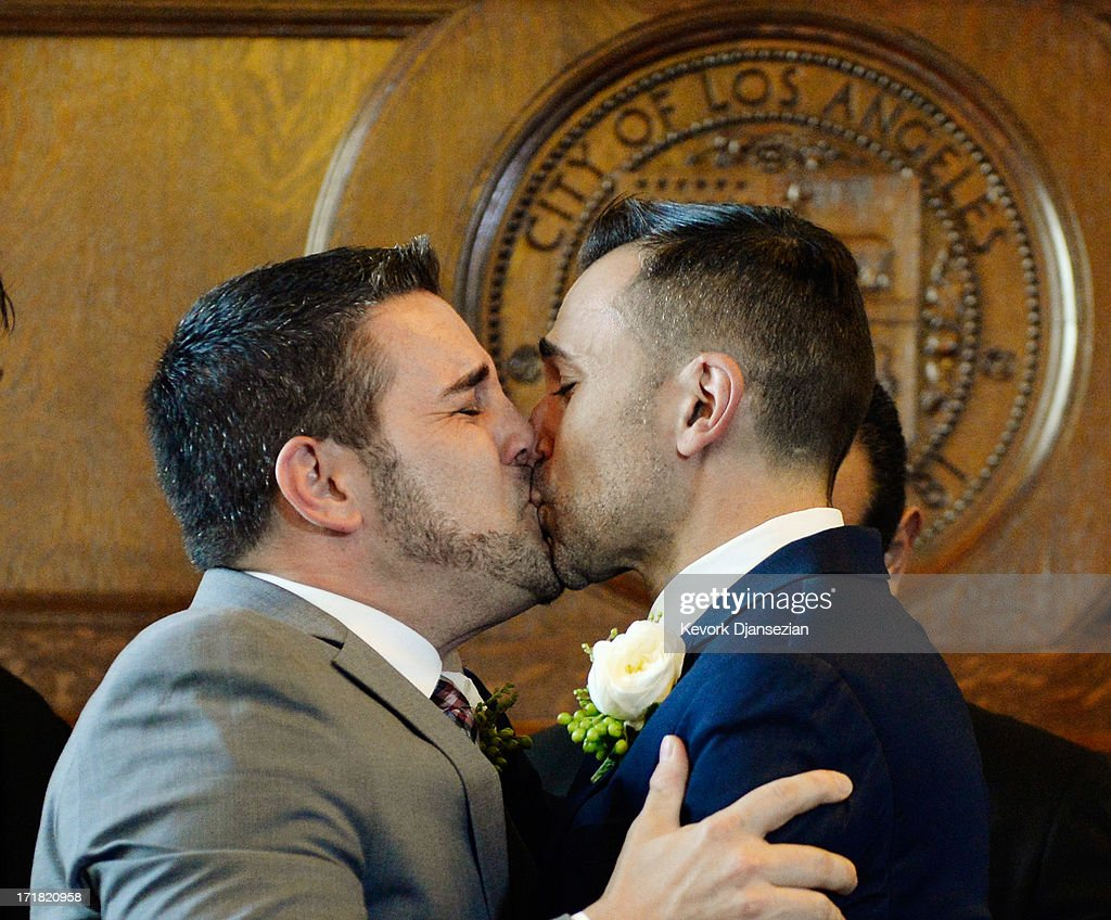 Same-sex couple Jeff Zarillo (L) and Paul Katami kiss after they were married at Los Angeles City Hall by Los Angeles Mayor Antonio Villaraigosa June 28, 2013 in Los Angeles, California. The U.S. Ninth Circuit Court of Appeals lifted California's ban on same-sex marriages just three days after the Supreme Court ruled that supporters of the ban, Proposition 8, could not defend it before the high court. California Gov. Jerry Brown ordered all counties in the state to begin issuing licenses immediately.