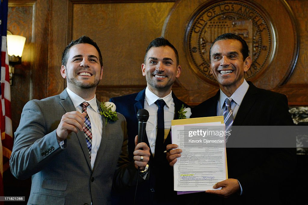 Same-sex couple Jeff Zarillo and Paul Katami pose after they were married at Los Angeles City Hall by Los Angeles Mayor Antonio Villaraigosa, holding the marriage certificate, June 28, 2013 in Los Angeles, California. The U.S. Ninth Circuit Court of Appeals lifted California's ban on same-sex marriages just three days after the Supreme Court ruled that supporters of the ban, Proposition 8, could not defend it before the high court. California Gov. Jerry Brown ordered all counties in the state to begin issuing licenses immediately.
