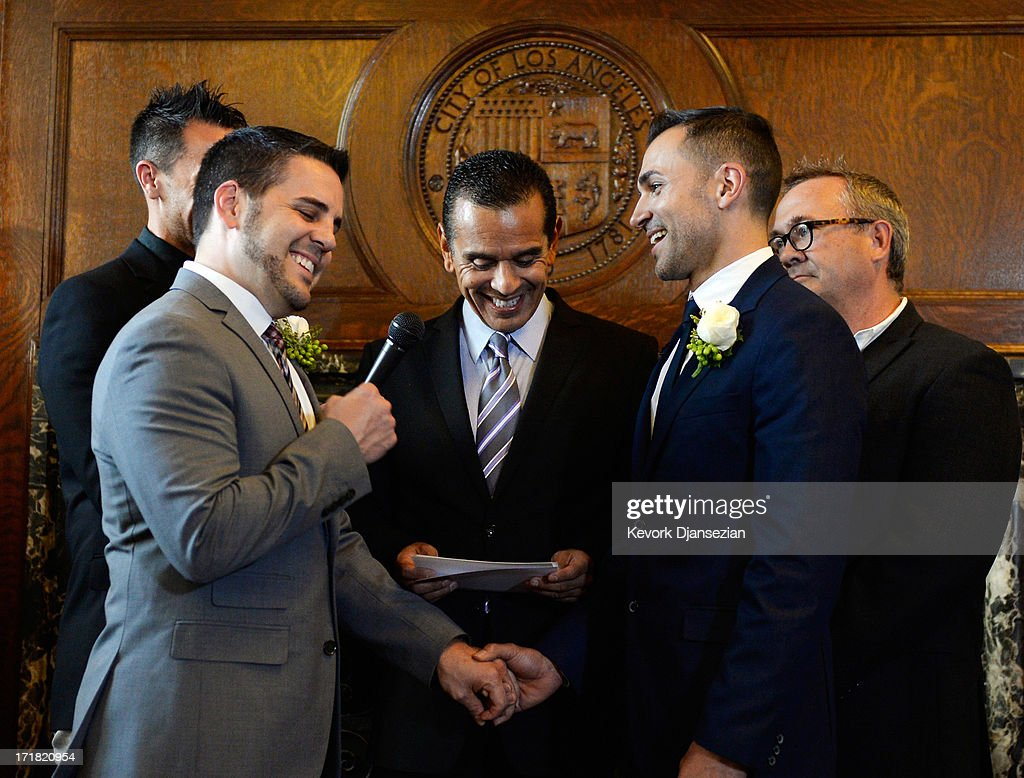 Same-sex couple Jeff Zarillo (L) pumps his fist as he and Paul Katami are married at Los Angeles City Hall by Los Angeles Mayor Antonio Villaraigosa (C) on June 28, 2013 in Los Angeles, California. The U.S. Ninth Circuit Court of Appeals lifted California's ban on same-sex marriages just three days after the Supreme Court ruled that supporters of the ban, Proposition 8, could not defend it before the high court. California Gov. Jerry Brown ordered all counties in the state to begin issuing licenses immediately.