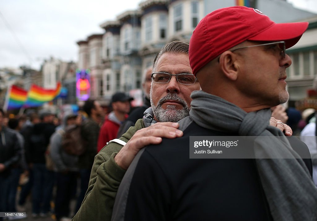 Same-sex couple Ken Mauldin (L) and Larry Davanzo embrace during a rally in support of marriage equality on March 25, 2013 in San Francisco, California. Supporters of same-sex marriage held a rally and are set to march through San Francisco a day before the U.S. Supreme Court will hear arguments on California's Proposition 8, the controversial ballot initiative that defines marriage as between a man and a woman.