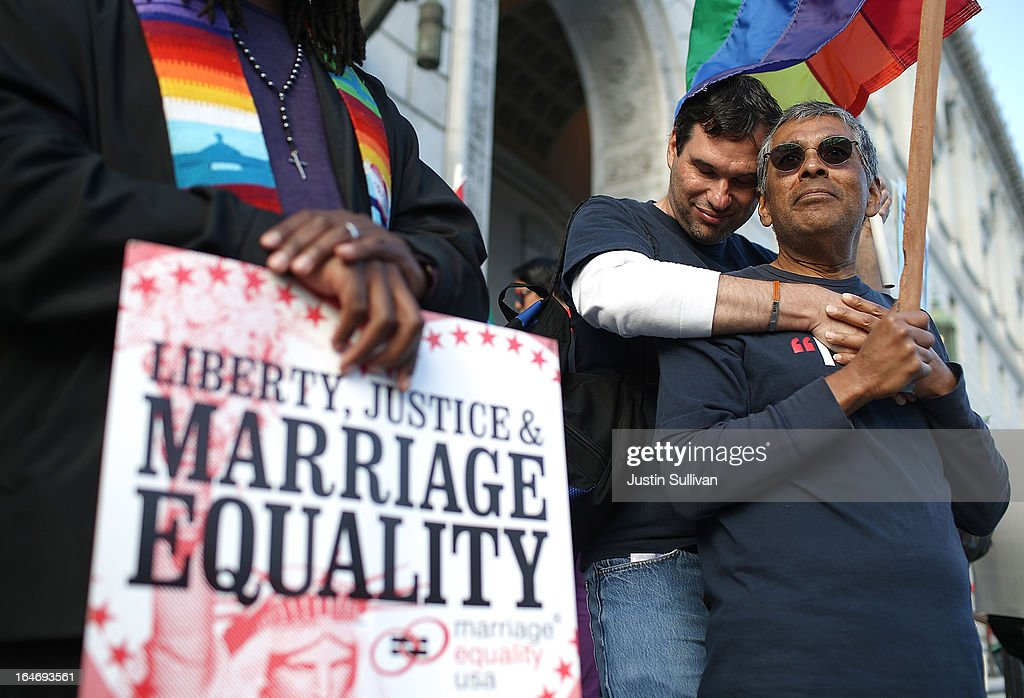 Same-sex couple Mark Guzman (R) Scott Coatsworth (L) embrace during a rally in support of marriage equality on March 26, 2013 in San Francisco, California. Supporters of same-sex marriage held a vigil after the U.S. Supreme Court heard arguments on California's Proposition 8, the controversial ballot initiative that defines marriage as between a man and a woman.