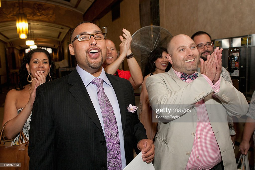 Same-sex couple Matthew Bautista (L) and John Chaich celebrate their nuptials during the first day of legal same-sex marriage in New York State on July 24, 2011 in New York City.
