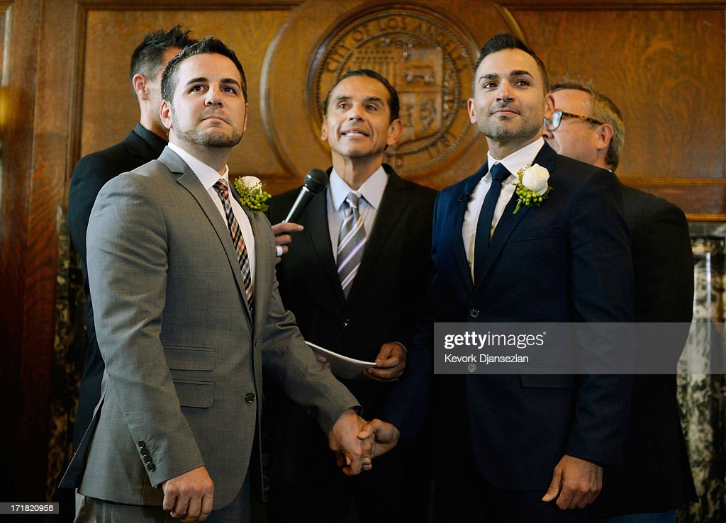 Same-sex couple Paul Katami (R) and Jeff Zarillo are married at Los Angeles City Hall by Los Angeles Mayor <a gi-track='captionPersonalityLinkClicked' href=/galleries/search?phrase=Antonio+Villaraigosa&family=editorial&specificpeople=178925 ng-click='$event.stopPropagation()'>Antonio Villaraigosa</a> on June 28, 2013 in Los Angeles, California. The U.S. Ninth Circuit Court of Appeals lifted California's ban on same-sex marriages just three days after the Supreme Court ruled that supporters of the ban, Proposition 8, could not defend it before the high court. California Gov. Jerry Brown ordered all counties in the state to begin issuing licenses immediately.