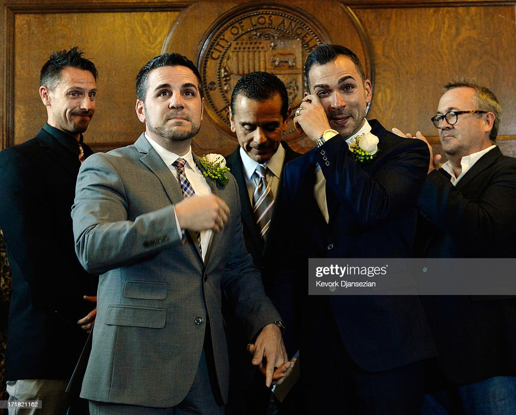 Same-sex couple Paul Katami (2R) and Jeff Zarillo (2L) are married at Los Angeles City Hall by Los Angeles Mayor <a gi-track='captionPersonalityLinkClicked' href=/galleries/search?phrase=Antonio+Villaraigosa&family=editorial&specificpeople=178925 ng-click='$event.stopPropagation()'>Antonio Villaraigosa</a> (C) as witnesses Devin Swanson (L) and Scott James look on, on June 28, 2013 in Los Angeles, California. The U.S. Ninth Circuit Court of Appeals lifted California's ban on same-sex marriages just three days after the Supreme Court ruled that supporters of the ban, Proposition 8, could not defend it before the high court. California Gov. Jerry Brown ordered all counties in the state to begin issuing licenses immediately.