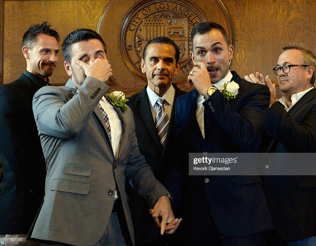 Same-sex couple Paul Katami (2R) and Jeff Zarillo (2L) wipe away tears after they were married at Los Angeles City Hall by Los Angeles Mayor <a gi-track='captionPersonalityLinkClicked' href=/galleries/search?phrase=Antonio+Villaraigosa&family=editorial&specificpeople=178925 ng-click='$event.stopPropagation()'>Antonio Villaraigosa</a> (C) as witnesses Devin Swanson (L) and Scott James look on, on June 28, 2013 in Los Angeles, California. The U.S. Ninth Circuit Court of Appeals lifted California's ban on same-sex marriages just three days after the Supreme Court ruled that supporters of the ban, Proposition 8, could not defend it before the high court. California Gov. Jerry Brown ordered all counties in the state to begin issuing licenses immediately.