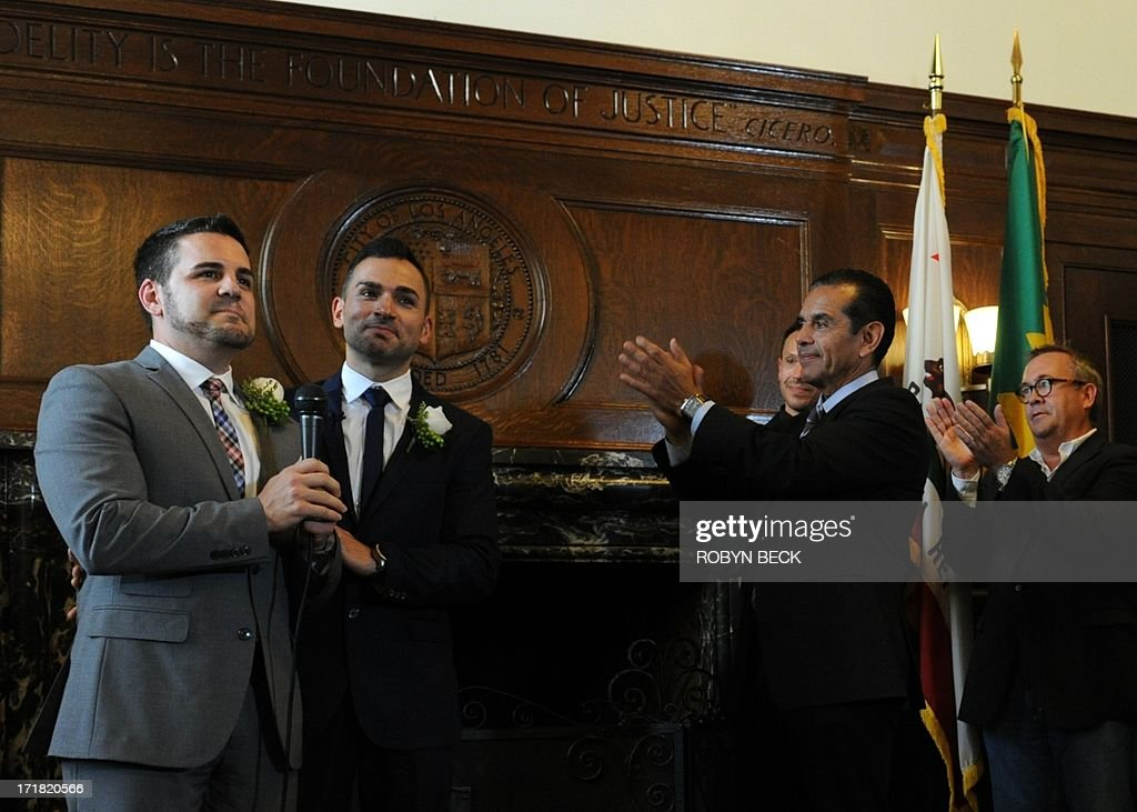 Same-sex couple Paul Katami (L) and Jeff Zarrillo (2nd-L) are applauded by Los Angeles Mayor Antonio Villaraigosa (C) after being married at Los Angeles City Hall June 28, 2013, becoming one of the first gay couples to marry in California since the Supreme Court refused to rule on Proposition 8 on June 26. Villaraigosa officiated the ceremony.