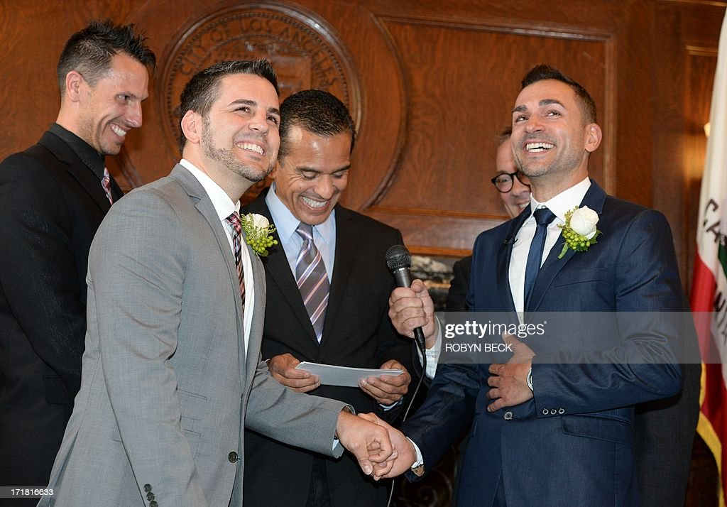 Same-sex couple Paul Katami (2nd-L) and Jeff Zarrillo (R) are married at Los Angeles City Hall June 28, 2013, becoming one of the first gay couples to marry in California since the Supreme Court refused to rule on Proposition 8 on June 26. Officiating at centger is Los Angeles Mayor Antonio Villaraigosa